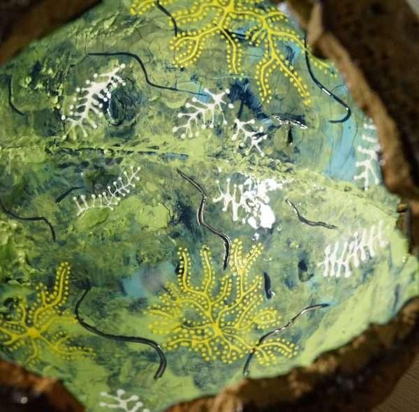 forest green pod sculpture